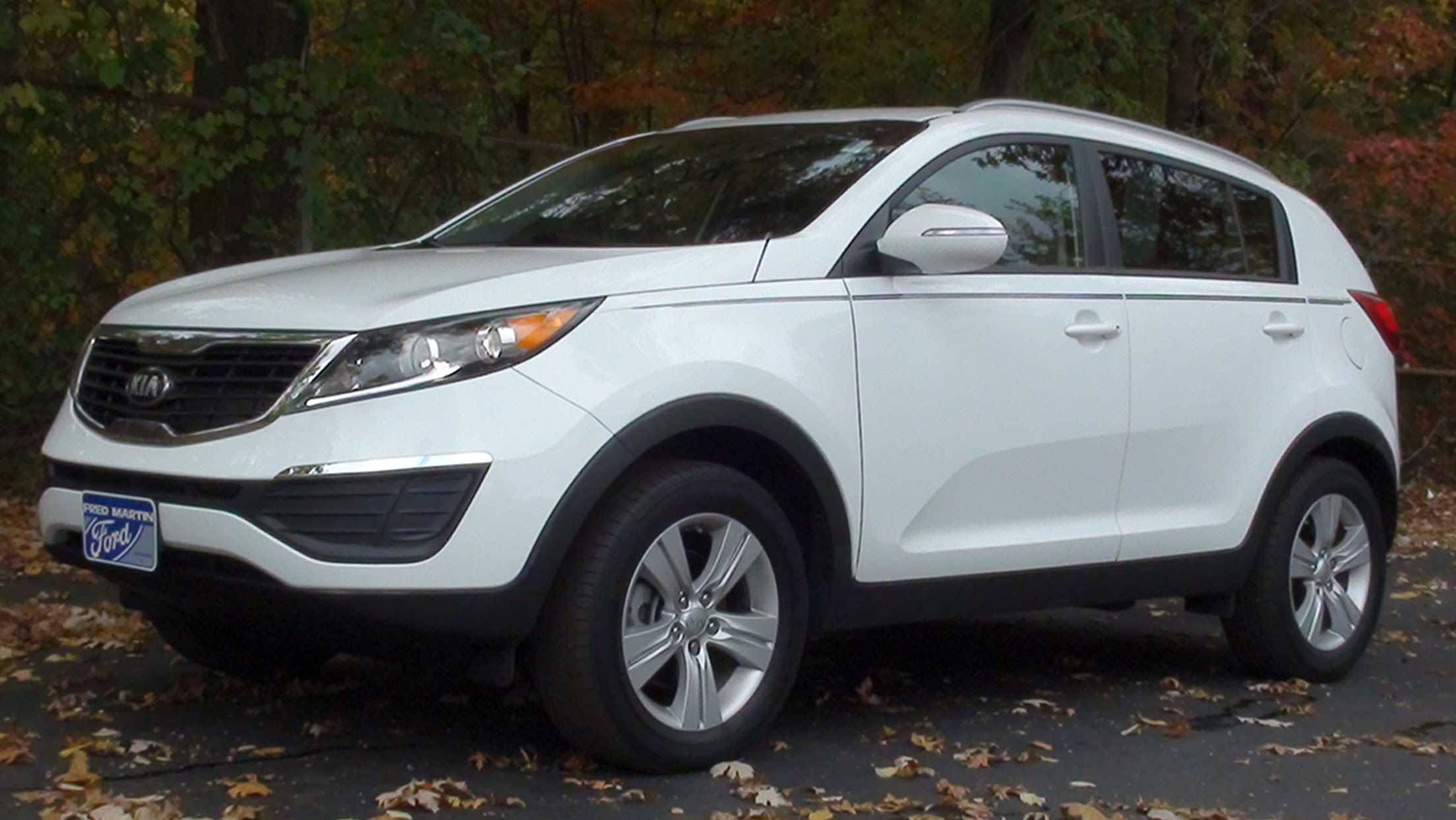 2013 kia sportage photos informations articles. Black Bedroom Furniture Sets. Home Design Ideas